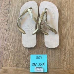 Havaianas, 37-38,tan, wide gold strap w/jewels,new